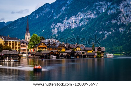Amazing scenery of austrian town Hallstatt at the lake and high mountains #1280995699
