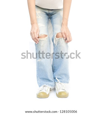 Young woman wearing torn jeans. #128105006