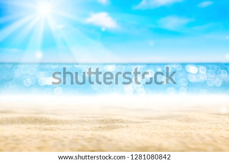 Blur tropical beach with bokeh sun light wave on blue sky and white cloud abstract background. Copy space outdoor summer vacation and travel adventure concept. Vintage tone filter effect color style. #1281080842