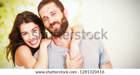 Portrait of young couple embracing at home #1281320416