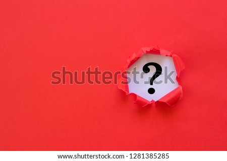 Question mark concept. Torn red paper with question mark on white background. #1281385285