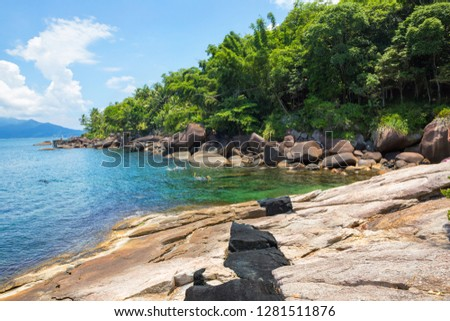 Summer day in calm and crystal clear waters, tropical climate. #1281511876
