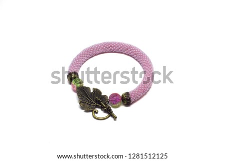 Handmade pink beaded bracelet with crackles and a toggle in the form of a leaf on a white background #1281512125