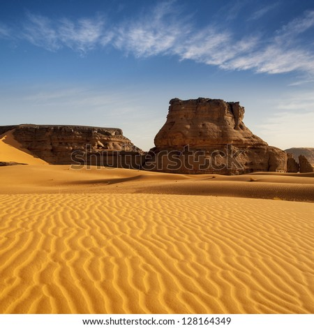 The Libyan desert - a fantastic place for travelers and photographers. Rocks of an unusual form, beautiful structure of dense yellow sand, dune of the huge sizes and deep sky of Sahara. #128164349