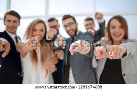 close up.a group of young business people pointing at you #1281674608
