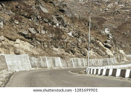 Highway road view of India China border near Nathu La mountain pass in Himalayas which connects Indian state Sikkim with China's Tibet Region, trisection point of Uttarakhand of India, Nepal and China #1281699901