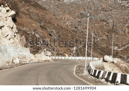 Highway road view of India China border near Nathu La mountain pass in Himalayas which connects Indian state Sikkim with China's Tibet Region, trisection point of Uttarakhand of India, Nepal and China #1281699904