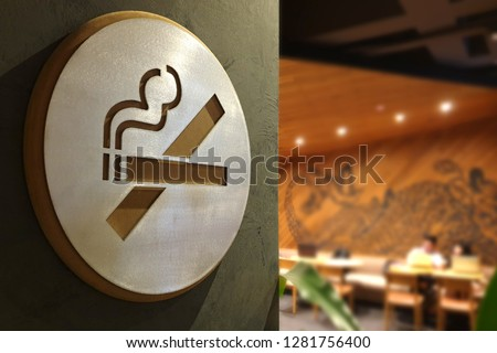 No smoking sign with bokeh restaurant background