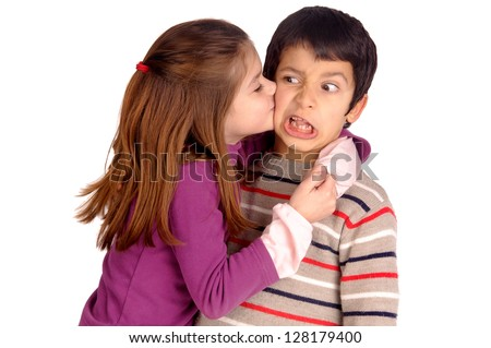 little girl kissing boy in the face