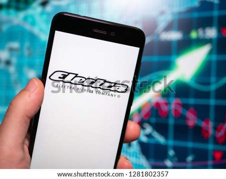 Murcia, Spain; Jan 8, 2019: Electra Bicycle Company logo in phone with earnings graphic on background. Electra Bicycle Company is a subsidiary of Trek Bicycle Company #1281802357
