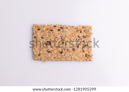 Diet flax seed whole grain cracker isolated on white background, soft light, top view, copy space #1281905299