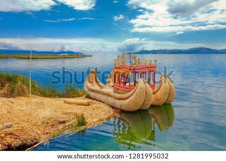 Totora boat on the Titicaca lake near Puno, Peru #1281995032