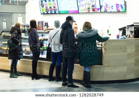 Novosibirsk 12-20-2018. People at the window in the cafe pastry fast food. #1282028749