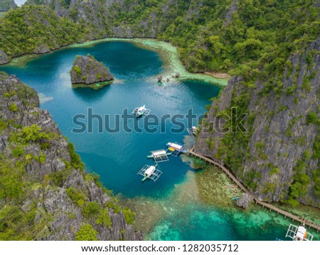 Aerial view to tropical lagoon with azure water and traditional sailing boats near Kayangan Lake, Coron island. Palawan, Philippines. #1282035712