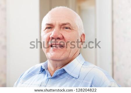 portrait of wistful grizzled senior man #128204822