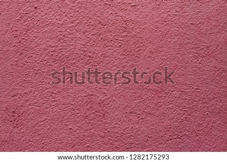 Dirty pink painted stucco wall on Burano Island in the Venetian Lagoon near Venice, Italy. Background texture. #1282175293