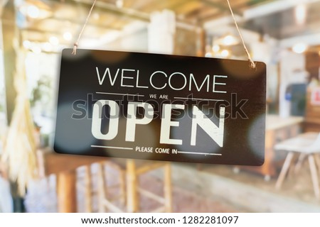 Welcome open sign use for any business in front of shop or online background. #1282281097