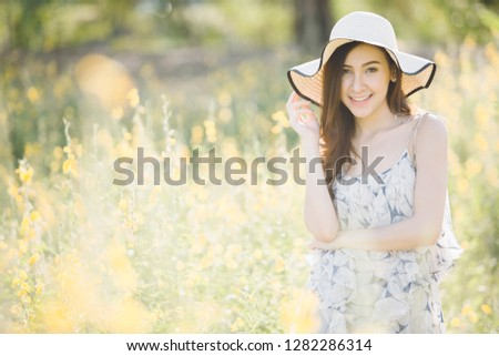 happy young woman enjoying summer in yellow flower field #1282286314