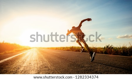 Athlete runner feet running on road #1282334374