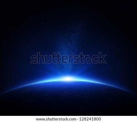 Earth - sunrise in deep blue space