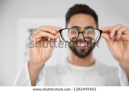 Male ophthalmologist with eyeglasses in clinic, closeup #1282449463