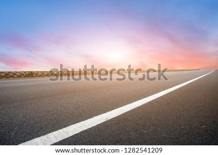 Sky Highway Asphalt Road and beautiful sky sunset scenery #1282541209
