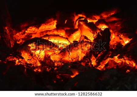The hot coals of a fire. Burning coals in the oven. Orange Heat. From the fire comes a very strong heat. Horizontal photography. #1282586632