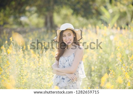 happy young woman enjoying summer in yellow flower field #1282659715
