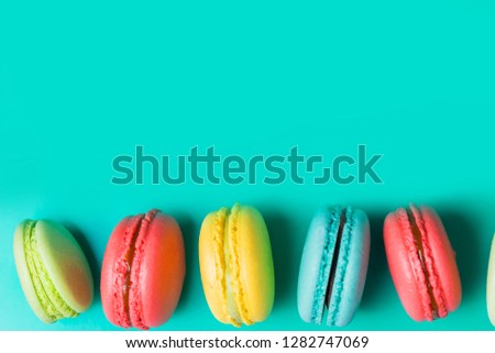 Beautiful fresh macaroon on turquoise background with copy space #1282747069