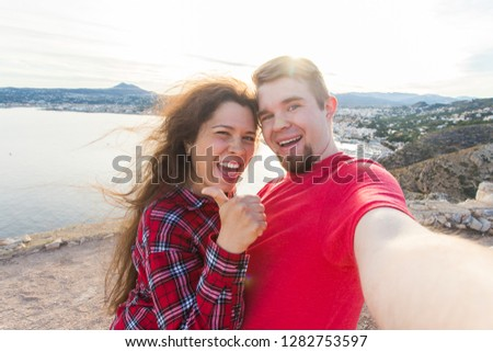 Travel, vacation and holiday concept - Happy couple taking selfie over beautiful landscape #1282753597