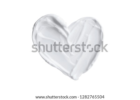 Heart shape from skincare cream or yogurt isolated on white background valentine's day creative concept #1282765504