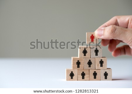 Human resource management concept by hand putting wood cube block leader on top pyramid. #1282813321