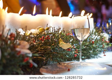 vine glass orchids and candles on the table #128285732
