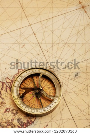 Old compass on map #1282890163