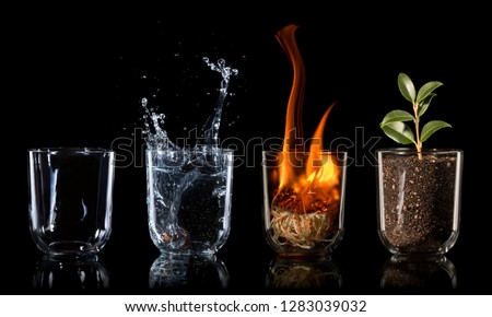 4 elements embodied as a concept in drinking glasses on black background, air, water, fire, earth Royalty-Free Stock Photo #1283039032