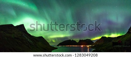 Panoramic view of Northern Lights, or Aurora Borealis, at Bergsbotn platform in Senja Island, Norway. #1283049208