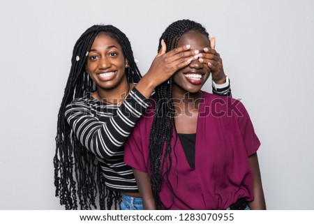 Portrait of two young african women make surprise and cover eyes on white #1283070955