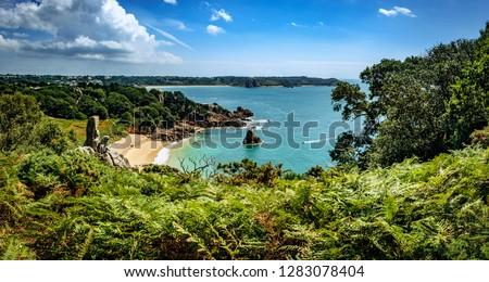 Idyllic Beach view over Beauport Bay, St. Aubin Royalty-Free Stock Photo #1283078404