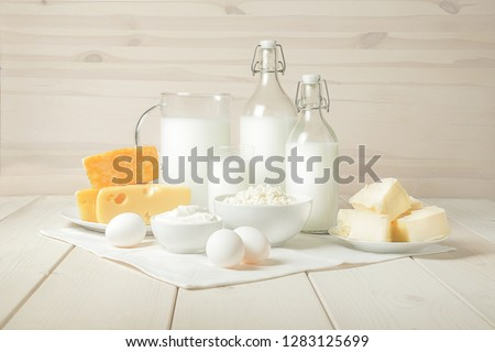 Milk, cottage cheese, sour cream, cheese, butter, eggs, still life from fresh dairy products. The usefulness of milk, dairy products from milk for adults and children. Still life of dairy products. #1283125699