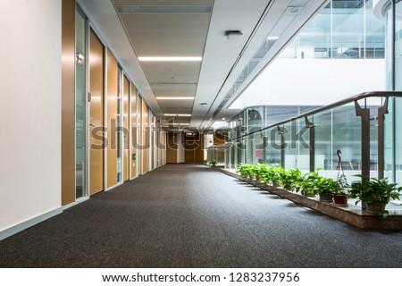 school, education and learning concept - empty school corridor #1283237956