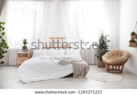Light modern room interior with comfortable bed #1283371225