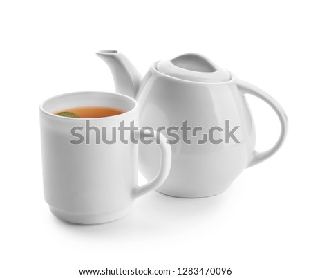 Teapot and cup of hot beverage on white background #1283470096