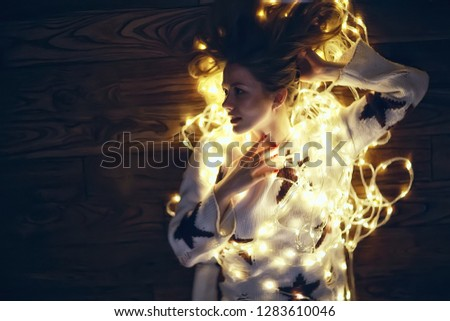 girl with Christmas garland / new year evening, funny illumination, portrait of a dream model #1283610046