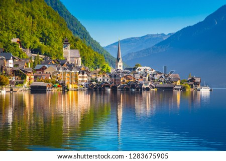 Classic postcard view of famous Hallstatt lakeside town in the Alps in scenic golden morning light at sunrise on a beautiful sunny day in summer, Salzkammergut region, Austria #1283675905