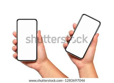 Woman hand holding the black smartphone with blank screen and modern frame less design two positions angled and vertical - isolated on white background #1283697046