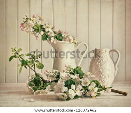 Still life of apple blossom flowers in vase on table #128372462