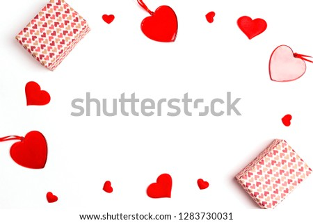 Romantic frame of gifts and hearts on white background. Valentines day background. Flat lay, top view, copy space.  #1283730031