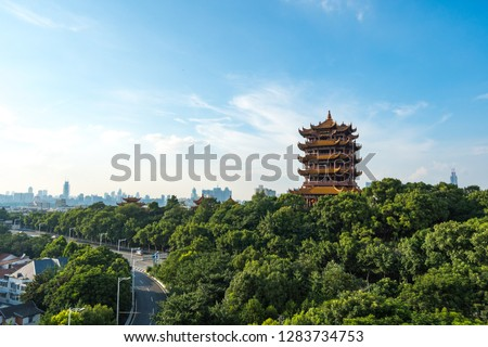 Aerial view of  Wuhan city .The yellow crane tower , located on snake hill in Wuhan, is one of the three famous towers south of yangtze river,China. Royalty-Free Stock Photo #1283734753