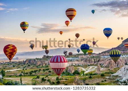 The great tourist attraction of Cappadocia - balloon flight. Cappadocia is known around the world as one of the best places to fly with hot air balloons. Goreme, Cappadocia, Turkey #1283735332