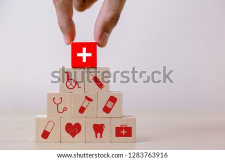 Health Insurance Concept,hand arranging wood block stacking with icon healthcare medical. #1283763916